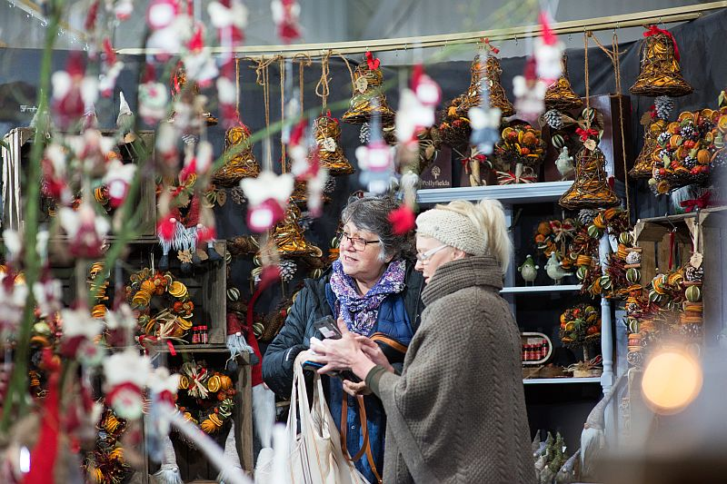 Comparing gifts at the Christmas Shopping Fayre in Exeter