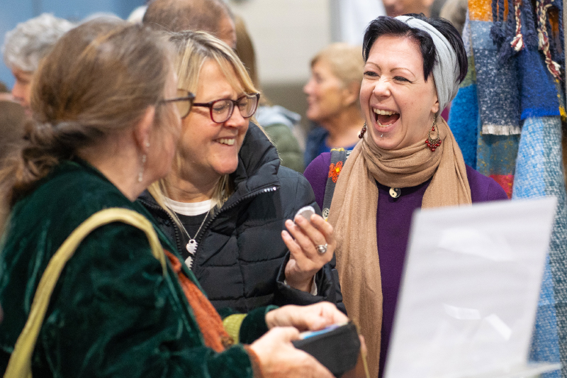 Laughing shoppers at the Christmas Shopping Fayre